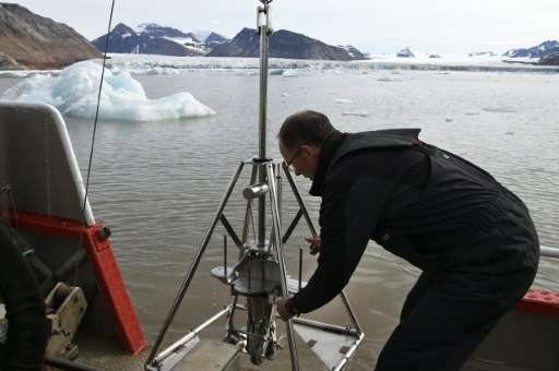 French oceanographer Philippe Kerherve takes samples from the Kongsfjorden fjord near the scientific base of Ny-Alesund on July