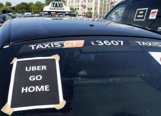 French taxis strike after weeks of rising tension over Uber