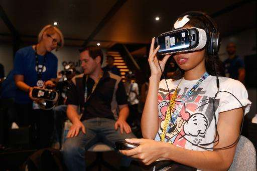 Gamers test the Samsung Gear VR powered by Oculus, at the Annual Gaming Industry Conference E3 in Los Angeles, on June 16, 2015