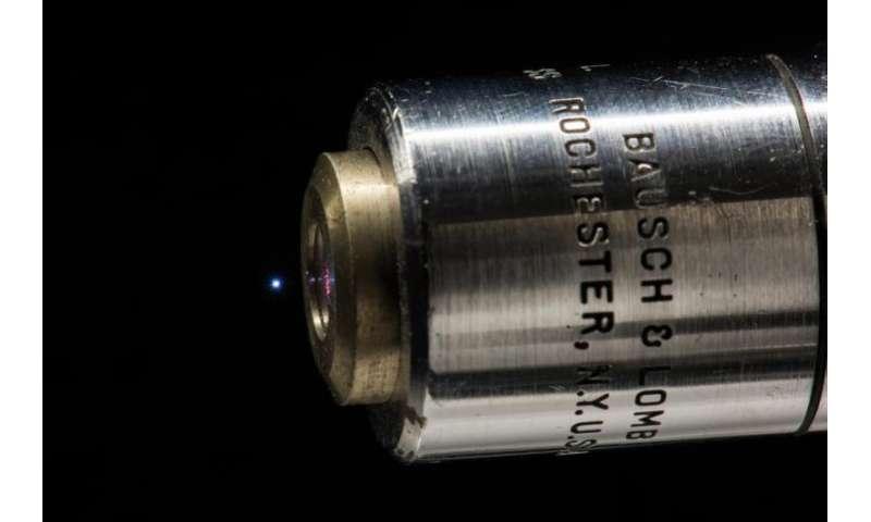 Generating broadband terahertz radiation from a microplasma in air