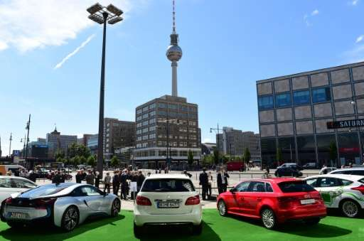 "German-made electric cars are displayed in front of the Berlin Congress Centre during a two-day national conference on ""Ele"