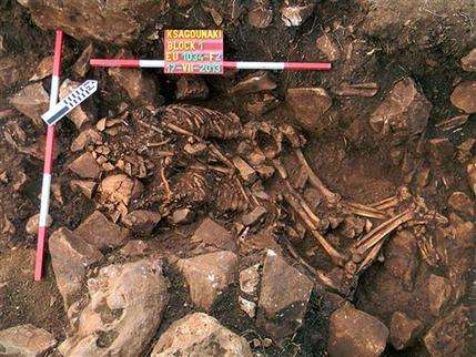 Greek archaeologists find couple locked in millennia-old hug