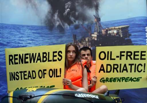 Greenpeace supporters protest against planned oil exploration in the Adriatic in Budapest on July 22, 2015