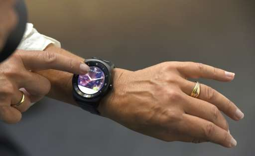 'G watch R', a wristwatch, is presented at the booth of South Korea's electronics giant LG, during the consumer electronics trad