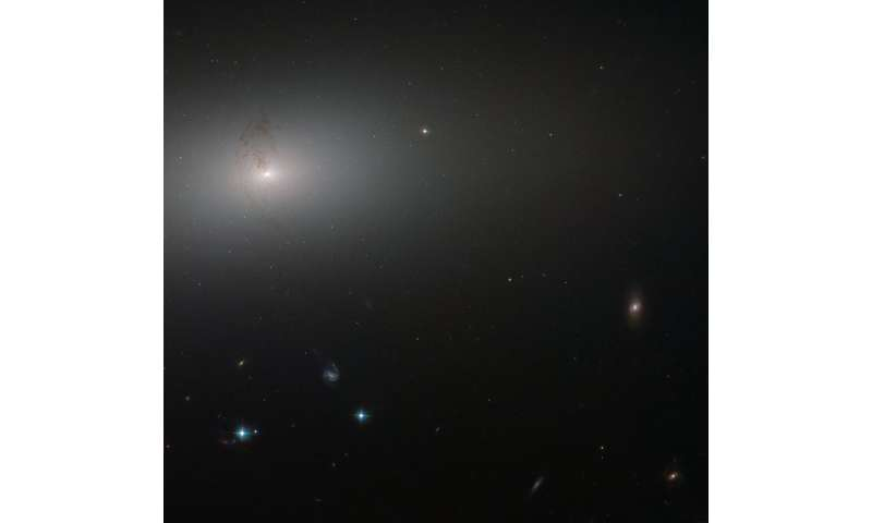 Hubble peers through the elliptical haze