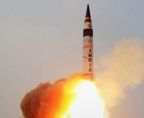India successfully uses a mobile launcher to test-fire a long-range missile capable of delivering a nuclear warhead into China.