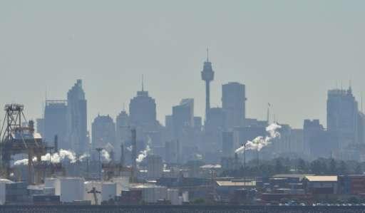 Industrial chimneys belch emmissions across Botany Bay in Sydney