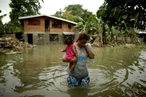Inundations from torrential weekend rains caused by Typhoon Koppu cascaded into coastal fishing and farming villages in the Phil