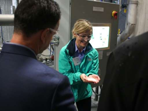 Jane Ritchie explains the carbon capture system at the opening of a Canadian Carbon Engineering pilot plant in Squamish, British