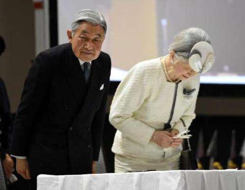Japanese Emperor Akihito and Empress Michiko bow while attending the opening ceremony of the third UN World Conference on Disast