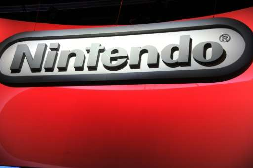 Japanese video game giant Nintendo said Wednesday it swung to a $67 million net profit in the three months to June, owing to a j