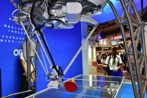 Japan's electronics maker Omron demonstrates a table tennis robot at a preview of Asia's largest electronics trade show CEATEC,