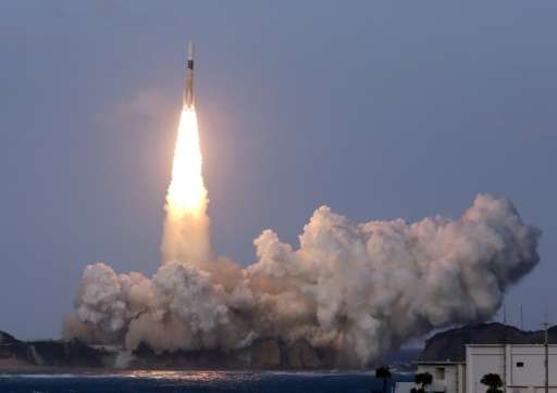 Japan's H-IIA rocket lifts off from the launch pad at the Tanegashima Space Center in Kagoshima prefecture on November 24, 2015