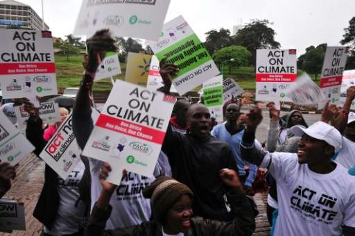 Kenyans call for climate justice at a demonstration on November 14, 2015, in Nairobi, as droughts and food-price increases illus