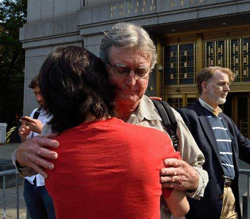 Kirk Ulbricht, father of Silk Road founder Ross Ulbricht, gets a hug from a friend outside the Federal Courthouse May 29, 2015 i