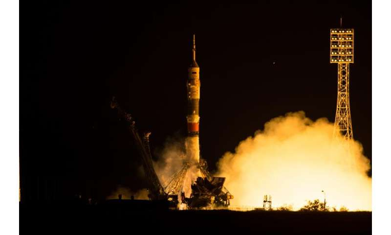 Launch, docking returns International Space Station crew to full strength
