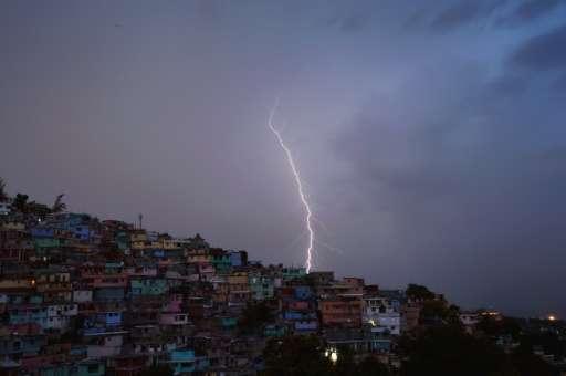 Lightning illuminates the skies of the Haitian capital Port-au-Prince during thunder storms on October 9, 2015
