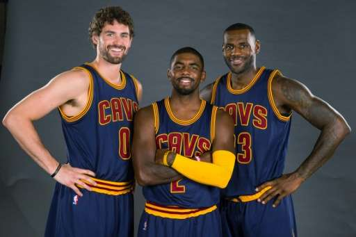 (L-R) Kevin Love, Kyrie Irving and LeBron James of the Cleveland Cavaliers pose during the Cleveland Cavaliers media day at Clev