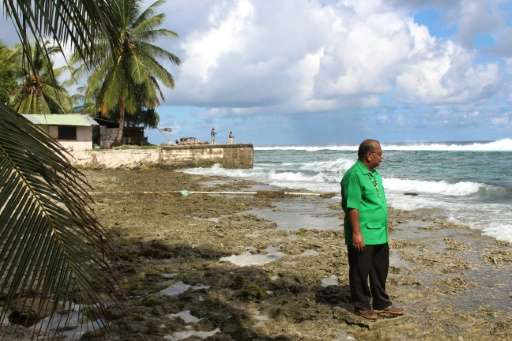 Marshall Islands President Christopher Loeak, pictured in 2014 in front of his home in Majuro, raised the height of a seawall ar