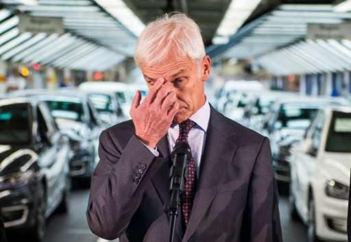 Matthias Mueller, CEO of German car maker Volkswagen, poses before addressing journalists at an assembly line of the VW plant in