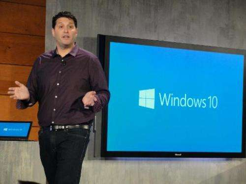 Microsoft executive Terry Myerson describes features being built into coming Windows 10 software at a press event in Redmond, Wa