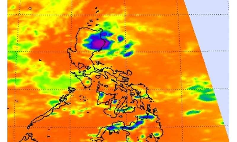 NASA sees newborn Tropical Depression 12W near northeastern tip of Philippines