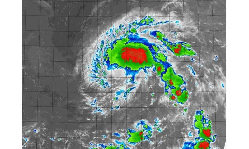NASA sees new tropical depression form near International Date Line