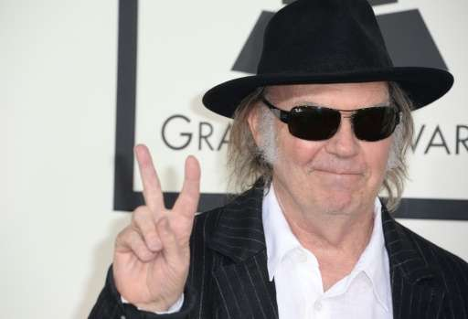 Neil Young arrives on the red carpet for the 56th Grammy Awards at the Staples Center in Los Angeles, California, January 26, 20