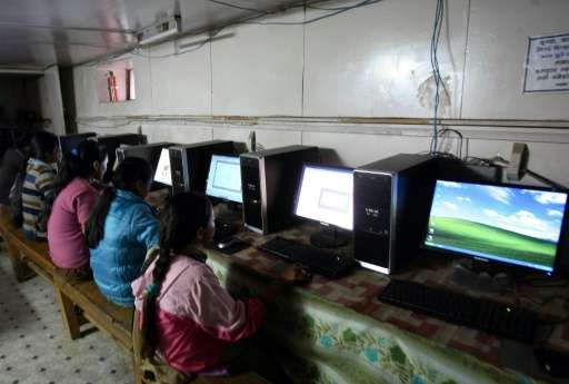 Nepalese girls surfing the internet in the village of Nagi, some 200 kms west of Kathmandu using home-made computers assembled i