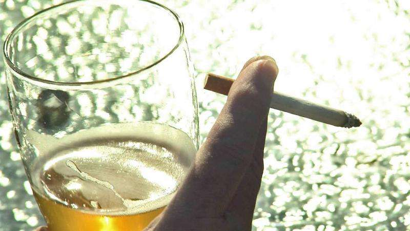 New finding helps explain why many alcohol drinkers also are smokers