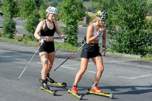 Norwegian athletes roller ski in Passy on July 23, 2015, before undergoing medical examinations for a research study, after havi