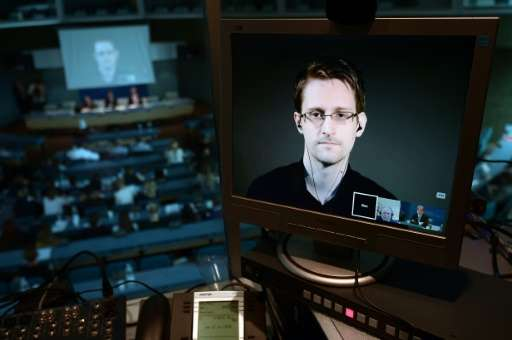 NSA former intelligence contractor Edward Snowden is seen via live video link from Russia on June 23, 2015