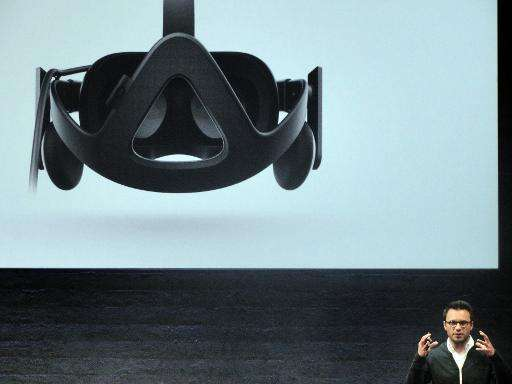 Oculus chief executive Brendan Iribe unveils Rift virtual reality head gear on June 11, 2015 in San Francisco, California