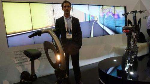 Ori Dadoosh, founder and CEO of Israeli startup Green Ride, with the company's folding electric scooter at the International CES