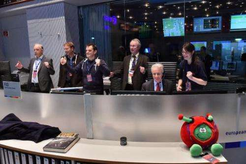 People celebrate in the Main Control Room at ESA's Operations Centre, ESOC, in Darmstadt, Germany, as separation of the Philae l