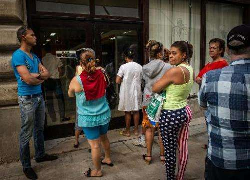 People queue at an Internet service provider in Havana, on January 20, 2015