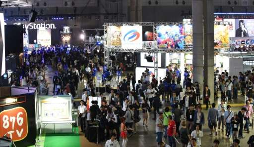 People visit the Tokyo Game Show in Chiba, on September 17, 2015