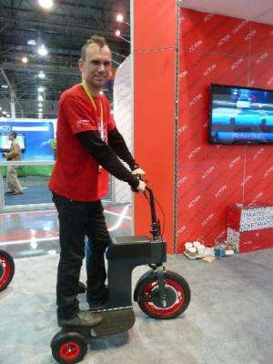 Peter Treadway of California-based startup Acton demonstrates the company's M-Scooter, one of several alternative transportation
