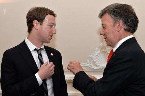 Picture released by the Colombian Presidency press office showing Colombian President Juan Manuel Santos (R) with Facebook found