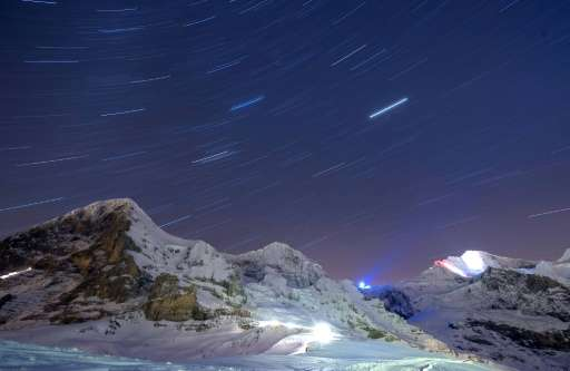 Record warm temperatures have been recorded at Switzerland's famous Jungfrau mountain (at right, seen in a long-exposure picture