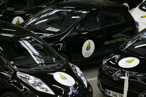 Renault's Leaf and Zoe electric vehicles, pictured November 16 2015 bearing stickers for the COP21 climate summit in Paris, are