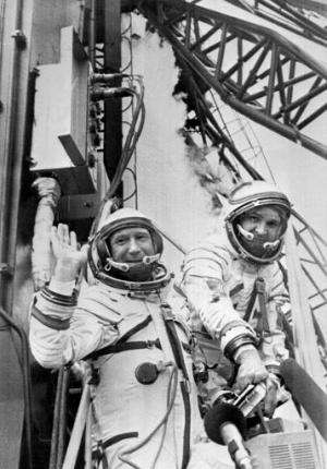 Russian cosmonaut Alexei Leonov (L) and his colleague wave while getting into their spaceship ready to be launched on July 15, 1