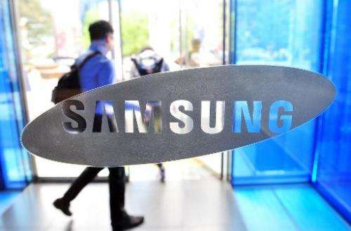 Samsung Electronics, the world's largest smartphone maker, posts its first drop in annual net profit in three years, on January