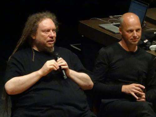 Sebastian Thrun (R), the founder of the Google X research library, looks on as virtual reality pioneer Jaron Lanier speaks at a