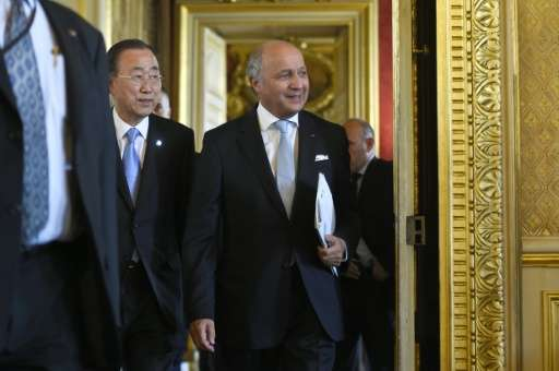 """Secretary General of United Nations, Ban Ki-Moon (L) and French Foreign Minister Laurent Fabius expressed """"prudent optimism"""