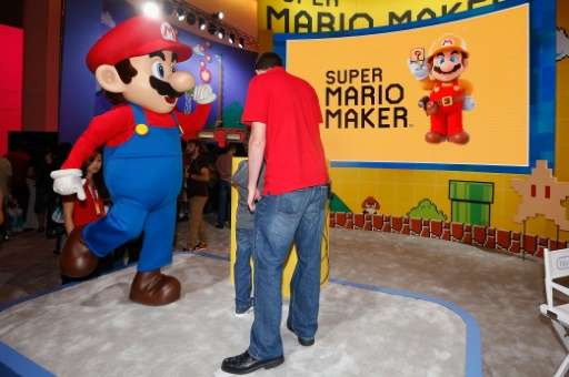 'Super Mario' performs at the Nintendo exhibit during the Annual Gaming Industry Conference E3, at the Los Angeles Convention Ce