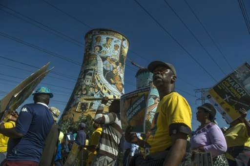 Supporters from South Africa's ruling party the ANC marched against power supplier Eskom in May to protest against power cuts in