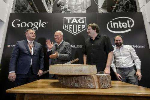 Tag Heuer Director General Guy Semon (L), CEO Jean-Claude Biver, Intel's new device general manager Michael Bell and Google's en