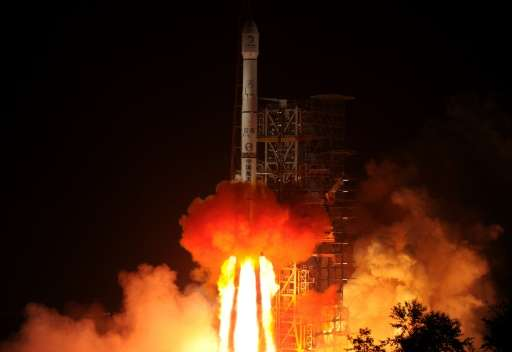 The Chang'e-3 rocket carrying the Jade Rabbit rover blasts off from the Xichang Satellite Launch Center in Sichuan province on D