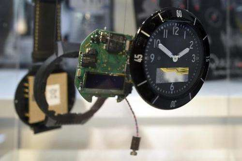 The clock Navigil S1 is presented in disassembled pieces during the 2015 Mobile World Congress in Barcelona on March 4, 2015